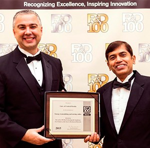 (from left) - Rob Bernath, business development manager at the UCF Office of Technology Transfer, and Jayan Thomas, UCF researcher, accept the R&D 100 Award honoring excellence in technology innovations at the annual awards banquet in Las Vegas.