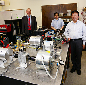 Maglev Chief Financial Officer Martin Epstein and UCF College of Engineering & Computer Science Professors Louis Chow and Thomas Wu with research equipment in Wu's lab