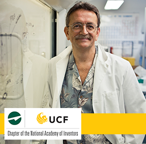 UCF inventor Dr. Hickman leaning on white board