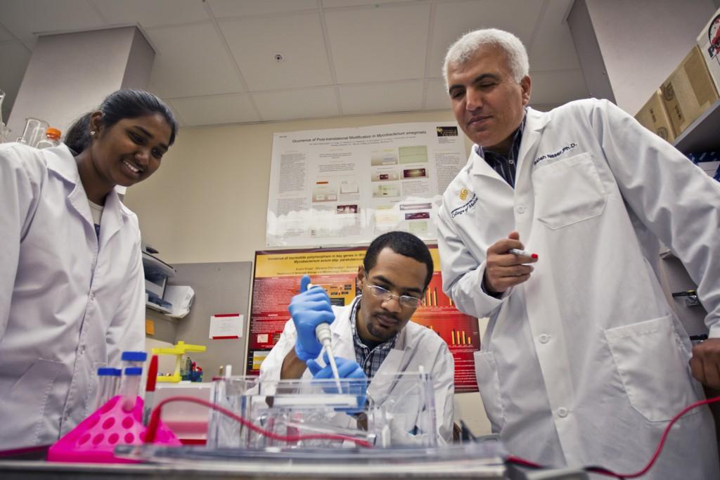 UCF Innovator Dr. Saleh Naser with graduate students
